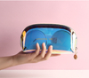 Factory high quality custom transparent cutch holographic PVC makeup pouch wholesale travel cosmetic bag laser